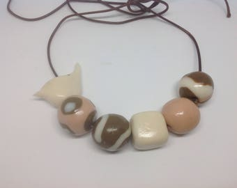 Toffee coloured polymer beads