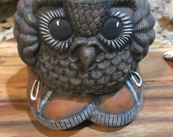 Adorable kitschy little owl in tennis shoes indoor planter. Herbs. Succulents