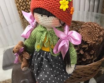 Hand made knitted  amigurumi doll- undressable and with full jair amd a Teddy Bear