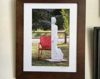 Red chair and statue