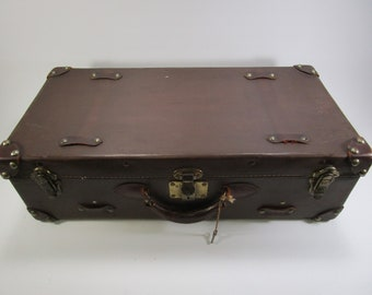 Vintage leather luggage suitcase with key