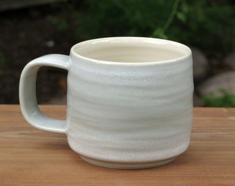 porcelain mug, wheel thrown mug, celadon mug. studio pottery mug, textured mug, pale blue green mug, coffee mug, pottery mug, handmade mug