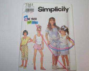 Simplicity Pattern 7351 Vintage 1991 UNCUT size 7-14 Girls and Child's skirt, capri pants, shorts and tops
