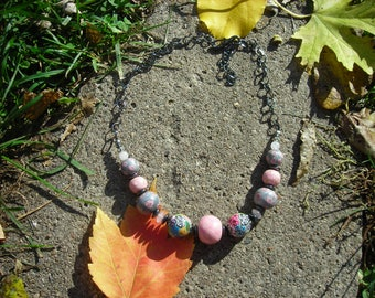 Pink floral choker made with gunmetal findings and handmade polymer beads.