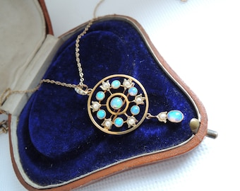 An Art Nouveau Opal and Seed Pearl Gold Brooch Pendant with Chain