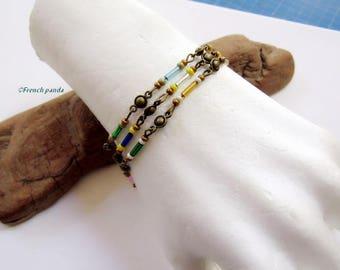 Bohemian bracelet bronze triple row convertible necklace.