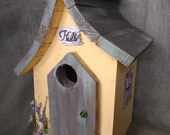 Yellow and grey birdhouse. Outdoor protectant, easy bottom clean out and hanger. Made in Michigan.
