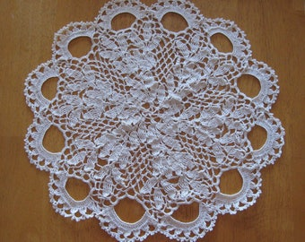 New ecru hand-crocheted doily