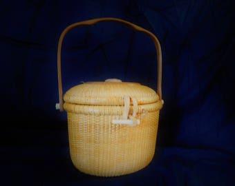 "8"" oval Nantucket purse."