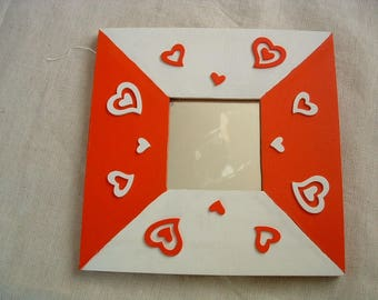 Mirror brimmed red and white with hearts reliefs