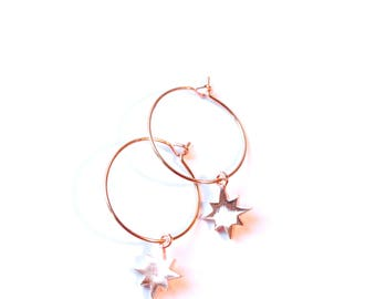 Rose gold hoop earrings, with northern star charms