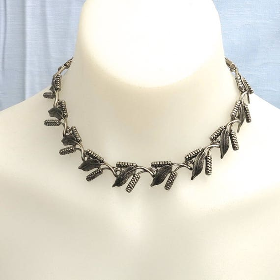 Vintage choker necklace with bottle brush flowers and leaves, Australian wildflowers, shepherd's hook, dark silver tone metal, mid century
