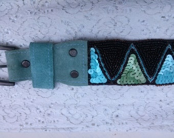 Hand sewn beads and Blue Suede belt