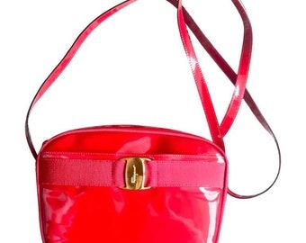 Vintage Salvatore Ferragamo vara collection patent enamel lipstick red shoulder bag with gold tone bow charm. Classic Ferragamo purse.