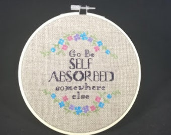 Naughty and Pretty Go be Self Absorbed Somewhere Else Finished in 6 inch ring Subversive Cross Stitch