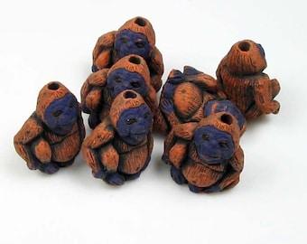 10 Tiny Orangatang Beads - CB472