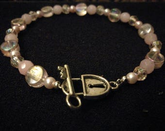 323. Baby Pink Bracelet With Lock & Key Toggle