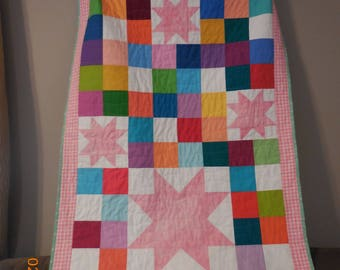 Modern baby quilt in bright colors with random star pattern