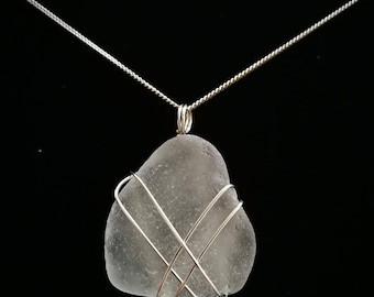 Wire wrapped clear sea glass pendant