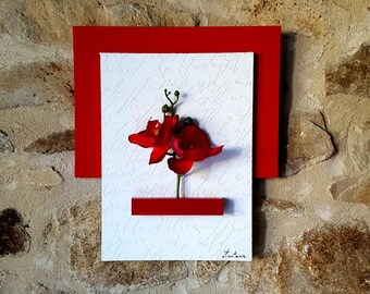 Red and white floral painting with writing and Red orchids
