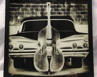 12x12 inch framed Instagram print of rock-a-billy bass and 1960 Chevy
