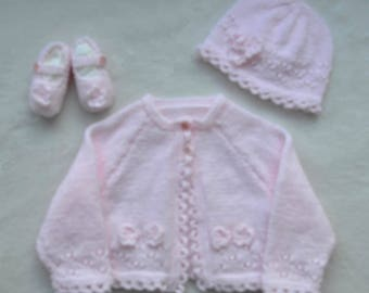 Beautiful baby gift set; cardigan, hat and little shoes all knitted by hand in baby four-ply yarn. Baby gift, baby shower
