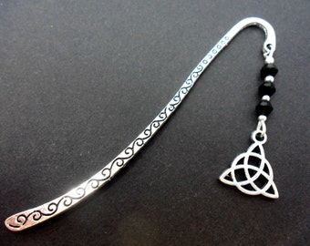 A tibetan silver and black crystal bead celtic knot charm  bookmark.