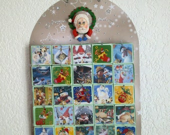 The 25 advent calendar squares with Santa Claus in cold porcelain