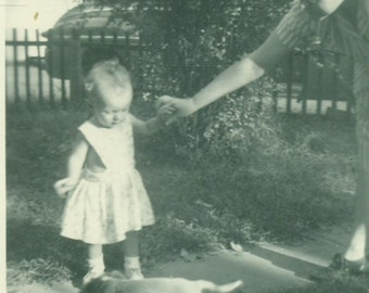 Little Toddler Girl Meeting a Puppy Outside on Side Walk With Mother 1930s  Black White Vintage Photo Photograph