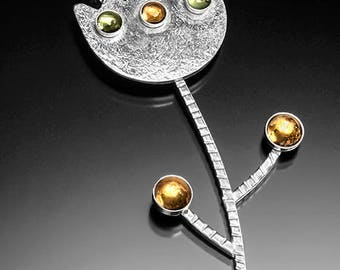 Modern art sterling silver flower pendant with citrines and peridot