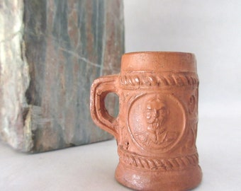 Antique Miniature / Redware Stein / Clay Mug / Collectible Pottery / 1 1/4 inch / Winking man / Crowned lady
