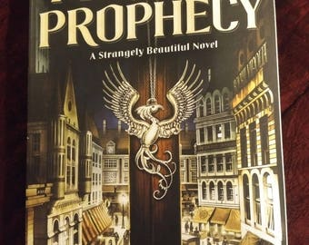 Signed, personalized copy of PERILOUS PROPHECY, a Strangely Beautiful novel. This is the revised new edition via Tor Books