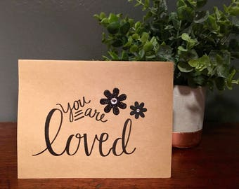 "greeting card: ""you are loved"""