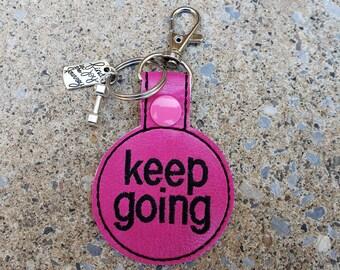 Keep Going Keychain With Charm