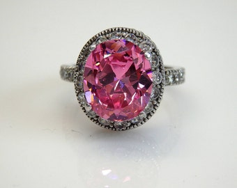 Sterling Silver Oval Shape Pink Cubic Zirconia  Clear CZ Accent Ring