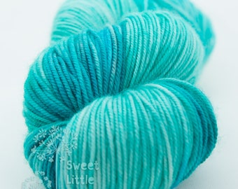 Beautiful hand dyed teal and blue hank of sports weight superwash merino wool