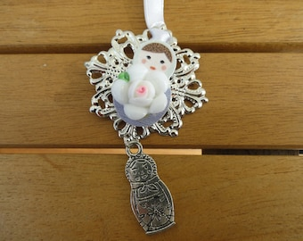 Christmas ornament - hanging print matryoshka button adorned with a white flower cabochon