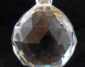 Very Large Clear Multi-faceted Solid Glass Very Wide Teardrop Bead Home Decoration on a White Lace Ribbon