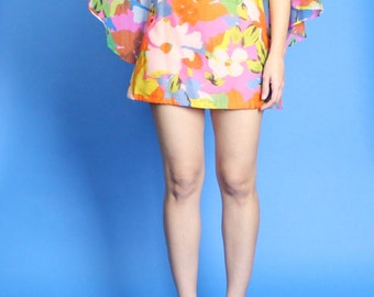 1960s.  Lawrence Dress Inc. colorful floral mini dress with attached cape. extra small-small