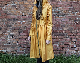 Golden raincoat in a shape of a dress