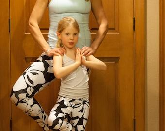 Mom Daughter Look Alike Leggings shown in Black and White Hibiscus
