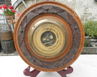 Antique Black Forest circular aneroid barometer carved with oak leaves