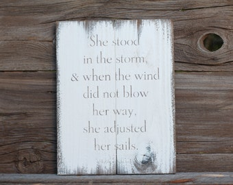 She stood in the storm, & when the wind did not blow her way, she adjusted her sails -  reclaimed wood sign