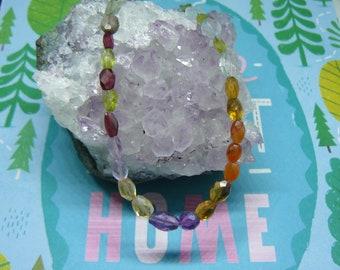 Multi gemstone necklace  featuring period , garnet , Amethyst , citrine
