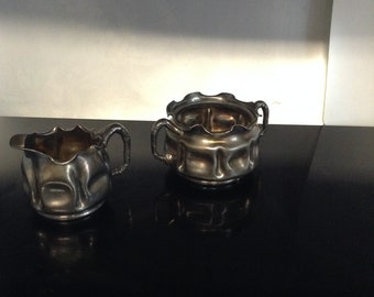 Pairpoint quadruple plate creamer and sugar