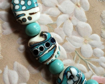 Turquoise black and ivory lampwork beads supplies glass