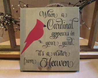 When A Cardinal Appears In Your Yard, It's A Visitor From Heaven wooden sign