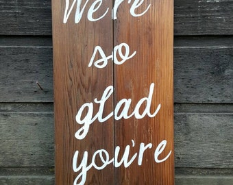"Handpainted Reclaimed Wood ""We're So Glad You're Here"" Sign"