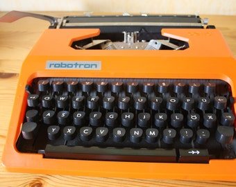 Vintage Orange typewriter - a portable DDR Cella Robotron - 1970s years