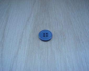 small blue button round with RIM